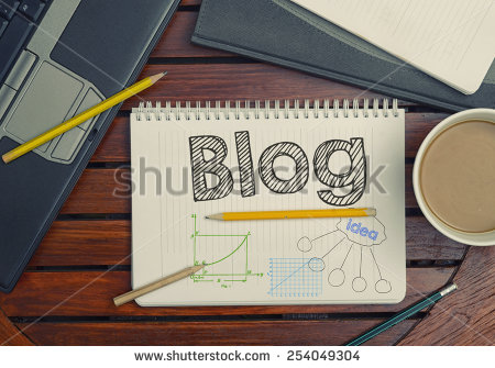 stock-photo-notebook-with-text-inside-blog-on-table-with-coffee-notebook-and-pencils-254049304